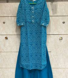 Blue Colored Bandhani Printed Kurti Along With Blue Skirt