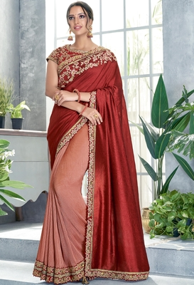 Dark red embroidered silk saree with blouse