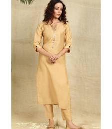 Beige Art Silk Kurti with Mukaish Work paired with Trousers