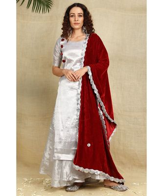 Silver cotton tissue kurti and flared palazzo paired with red velvet duppatta