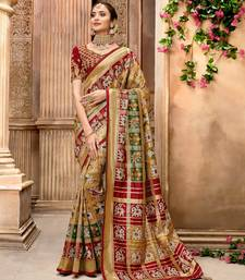 Golden woven pure silk saree with blouse