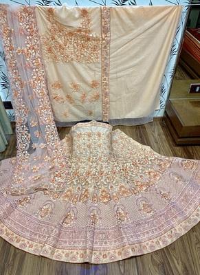 Peach embroidered net semi stitched lehenga