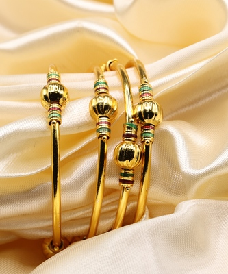 Set Of Four Bangles In Gold Color