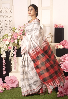 Cloud White Ikkat Saree With Black And Red Checkered Pallu