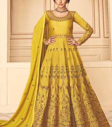 Yellow Embroidery Pure Silk semistich Traditional Dull Santoon Salwar Suit.