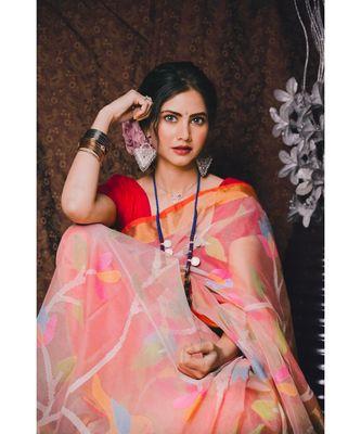 Stunning resham silk jamdani saree in peach with all over multi colour floral work