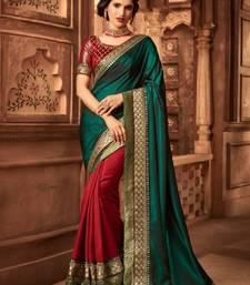 Dark green embroidered art silk blend saree with blouse