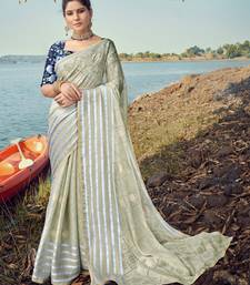 Off white printed brasso saree with blouse