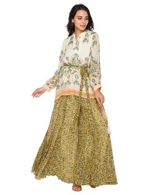 yellow  printed asymetrical top paired with sharara pants and belt
