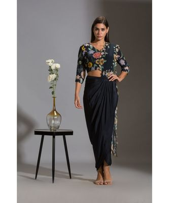 drape saree with cutwork embroidery paired with v neck blouse
