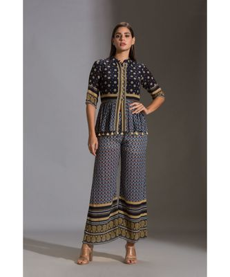printed peplum top with front opening and potli buttons. The peplum has tassel detail and is paired with printed pants
