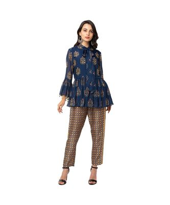 printed top with gatheres at waist and bell sleeves , paired with printed pants with side panel embroidered