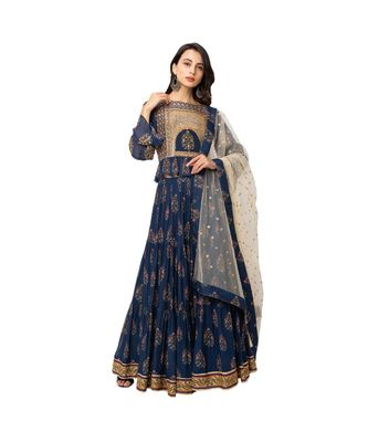 printed crop top with balloon sleeves and frill on waist is paired with three  tiered skirt paired with net dupatta