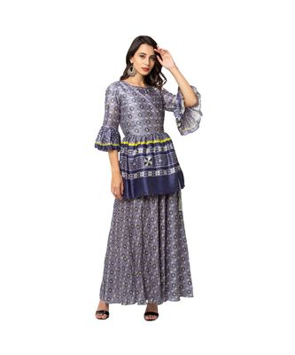 overlap printed top with gatheres at waist and bell sleeves is paired with bias cut skirt
