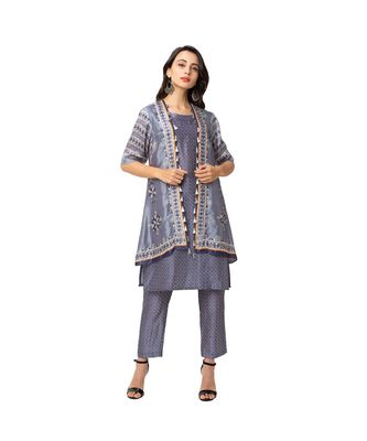 printed sleeveless A line kurta with ciggarette pants is paired with asymetrical top
