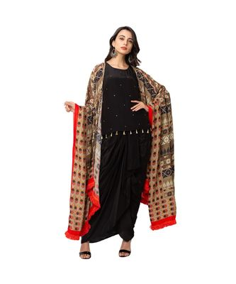 A line top with tassel detail and embroidery is paired with dhoti skirt and printed cape