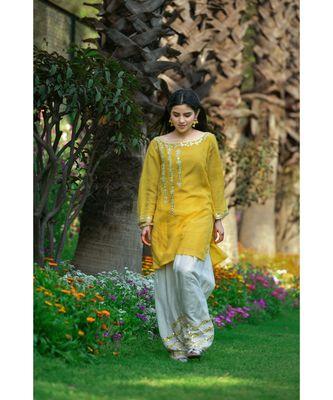 Yellow short kurta with white salwar
