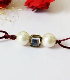Buy Kundan and Pearl Maroon Thread Designer Rakhi thread-rakhi online