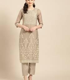 Beige chanderi Jharoka Embossed printed Straight Kurta with overall elastic Trouser