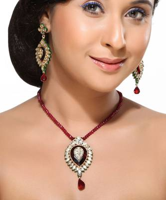 Kundans and Ruby Pendant Earring Set