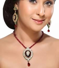 Buy Kundans and Ruby Pendant Earring Set Pendant online
