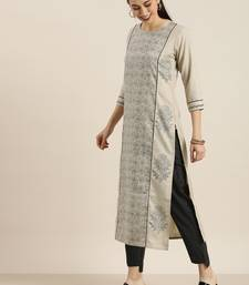 Beige And Black Floral Printed Kurta With Black And White Stripe Woven Trouser.