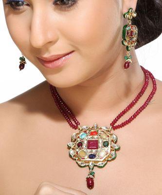 Nine gemstone kundan pendant set.