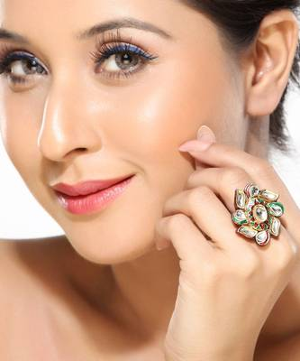A Kundan Ring with white sapphires