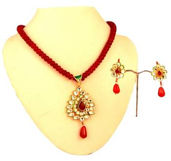 Kundan Pendant Set with matching earrings. Red Hangings.