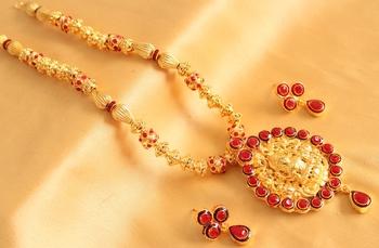 Splendid Goldplated Designer Pink Lakshmi Pendant Necklace With Earrings