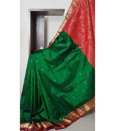 Green with maroon red handloom small Ghatti border pure south silk saree.