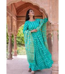 This is upada silk gown with hand tie and die leheriya along with banarsi dupatta