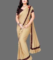 Beige plain lycra saree with blouse