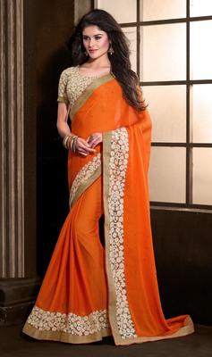 Orange embroidered chiffon saree with blouse