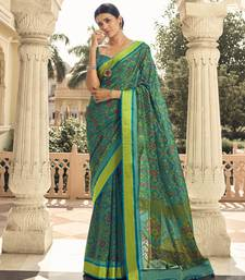 Teal printed brasso saree with blouse