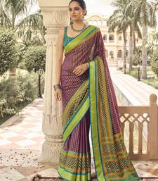 Light green printed brasso saree with blouse