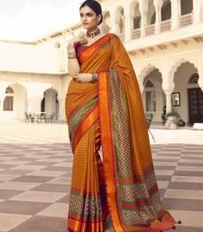 Dark orange printed brasso saree with blouse