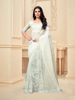 White embroidered fancy fabric saree with blouse