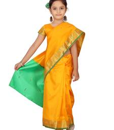 Yellow plain silk stitched saree