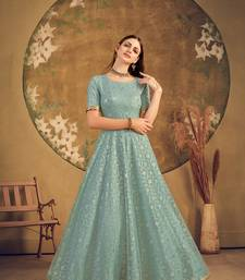 pista green taffeta semi stitched  gown with inner