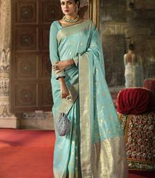 Turquoise woven silk saree with blouse