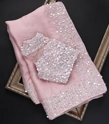 Baby pink embroidered organza saree with blouse
