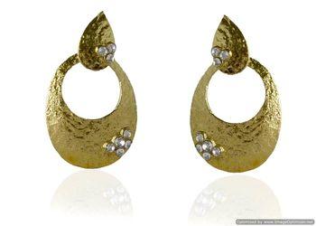 Kshitij Jewels Stone Studded Golden Oval Earrings