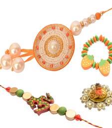 Buy Auspicious Designer Pearl and Om Family Rakhi Set bracelet-rakhi online