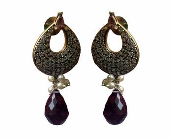 A pair of purple coloured earrings